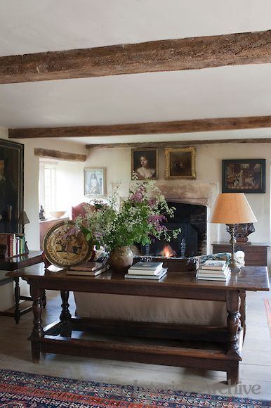 English cottage style with beams art books flowers low ceilings