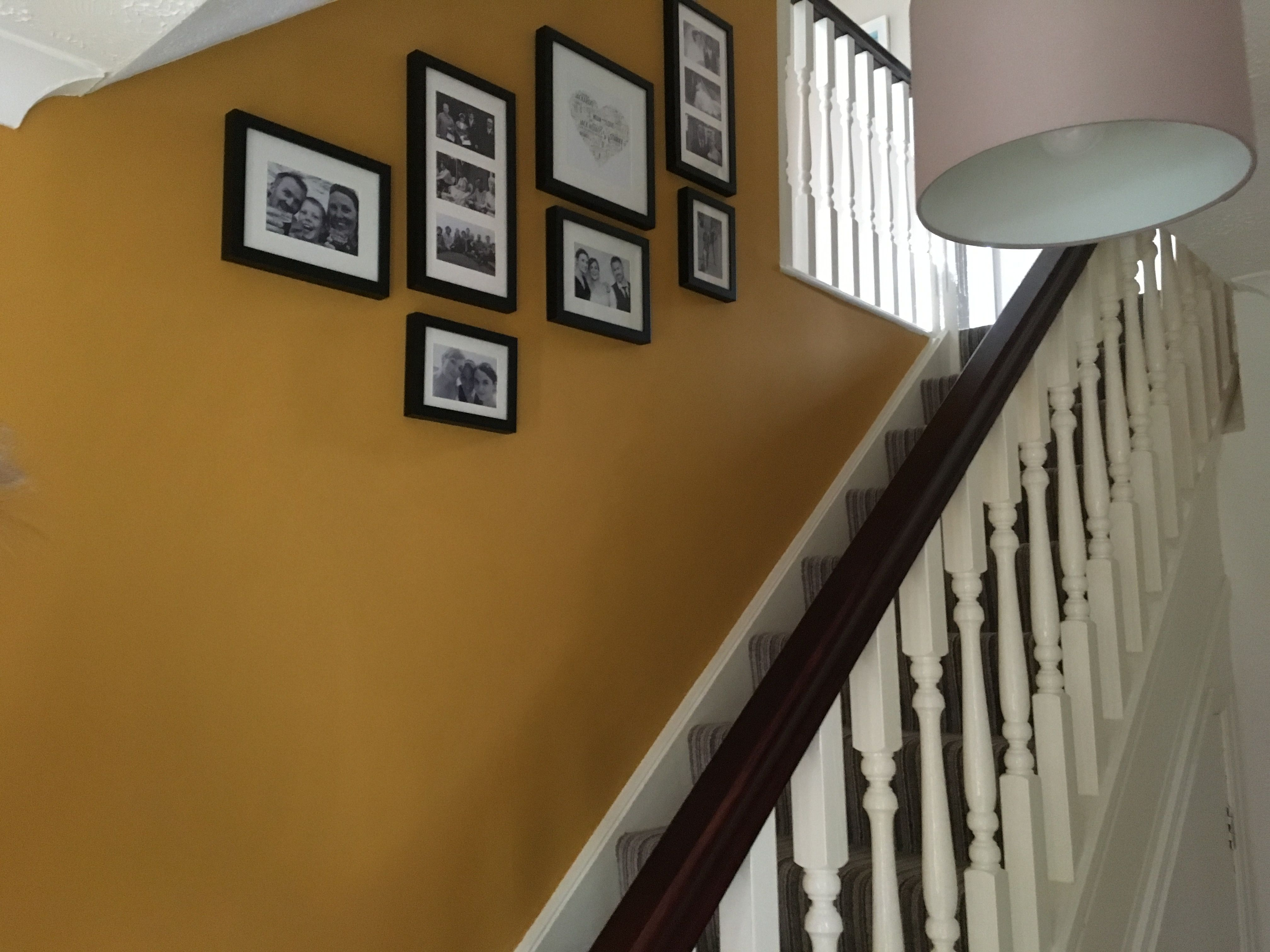mustard stairs photo wall | staircase wall decor, yellow
