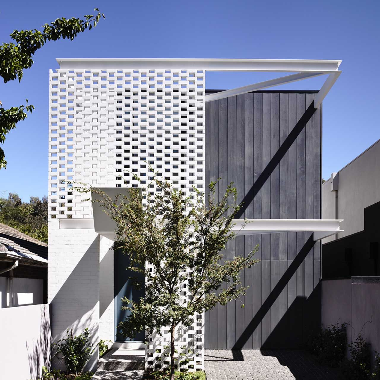 House with a perforated brick screen wall b v for Perforated brick wall