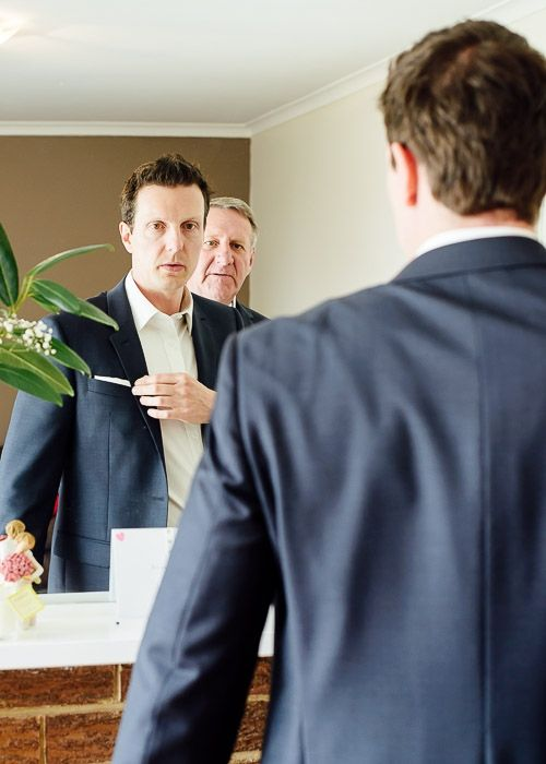 Groom preparing for his wedding, fixing pocket square handkerchi #wedding #photography #melbourne #weddingphotography #ballarareceptions