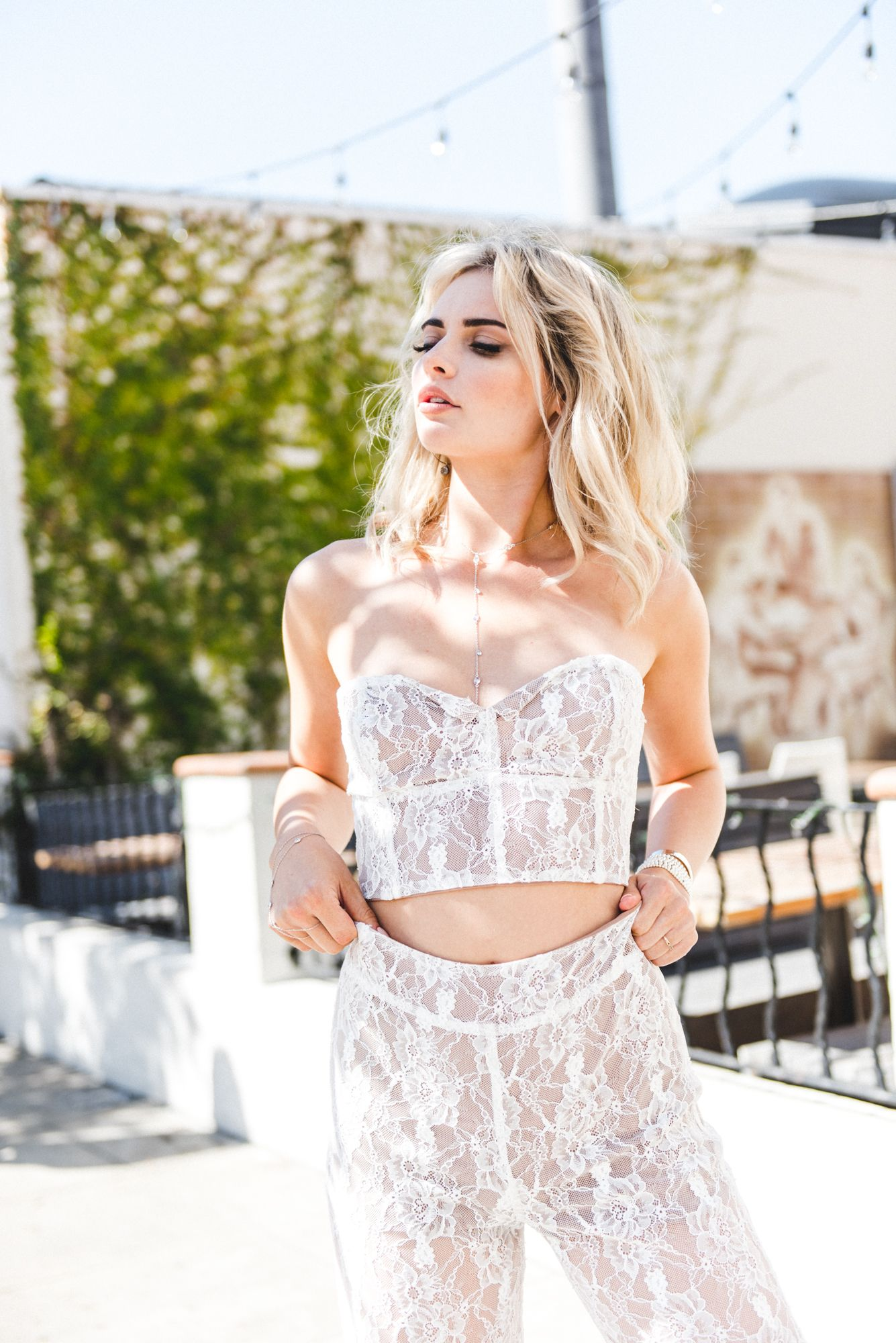 9c6aef0f88724 Coachella Outfits to Try  We re loving the For Love and Lemons lace  matching set with corset strapless top and high waisted lace pants