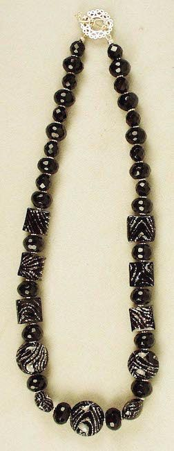 """VENETIAN BLACK & SILVER Unusual Murano glass square and round black beads with sparkling silver throughout. Accented with faceted black onyx.  Length: 22"""""""