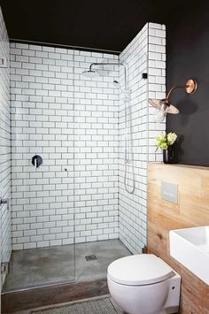 So Bold With The Mix Of Materials Black Walls White Tiles Concrete Floor Timber Wall And Copper Lighting