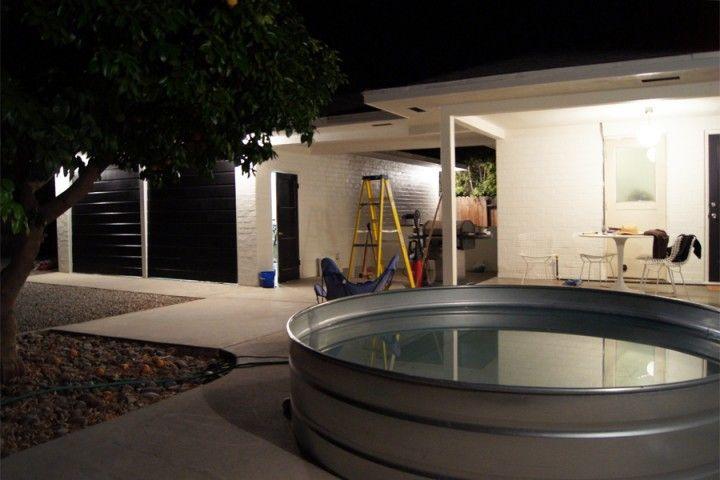 Interesting hot tub idea galvanized horse trough for Galvanized water trough swimming pool