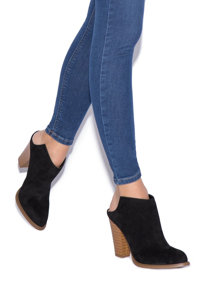 05b95a436 Look extra trendy in these mule-inspired booties that feature an open back.  Slip Samina on when you're in a rush for a quick and fashionable exit.