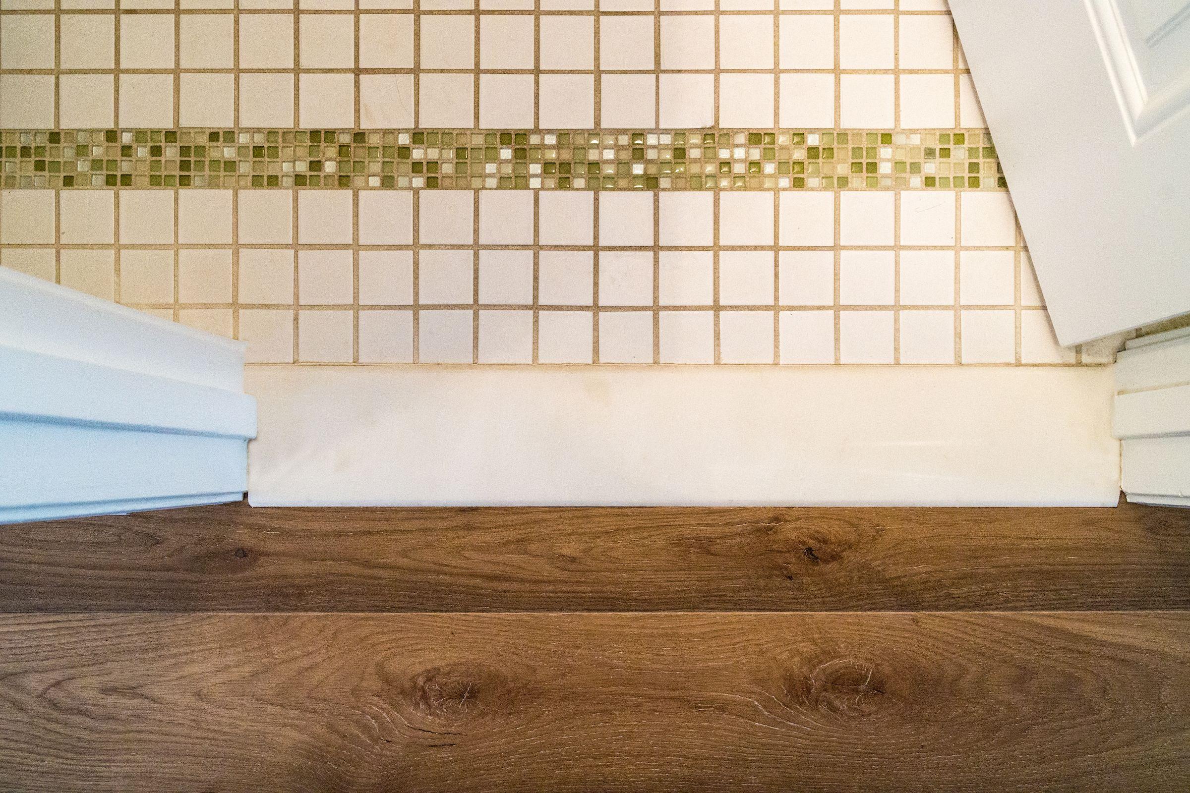 Lake house hardwood flooring nautical wide plank white oak hardwood flooring transitions to bathroom tile