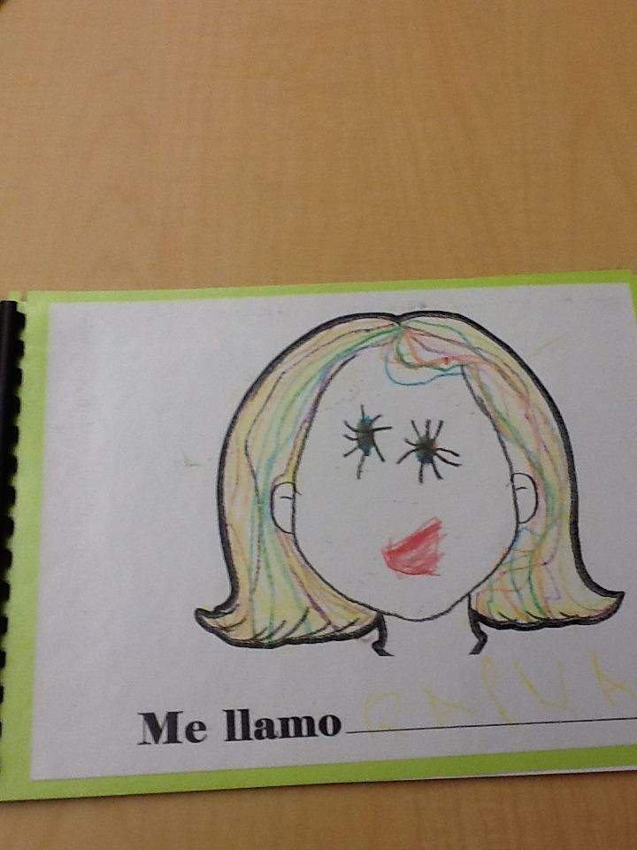 The Pre-Kindergarten students are making a book during Spanish class ...