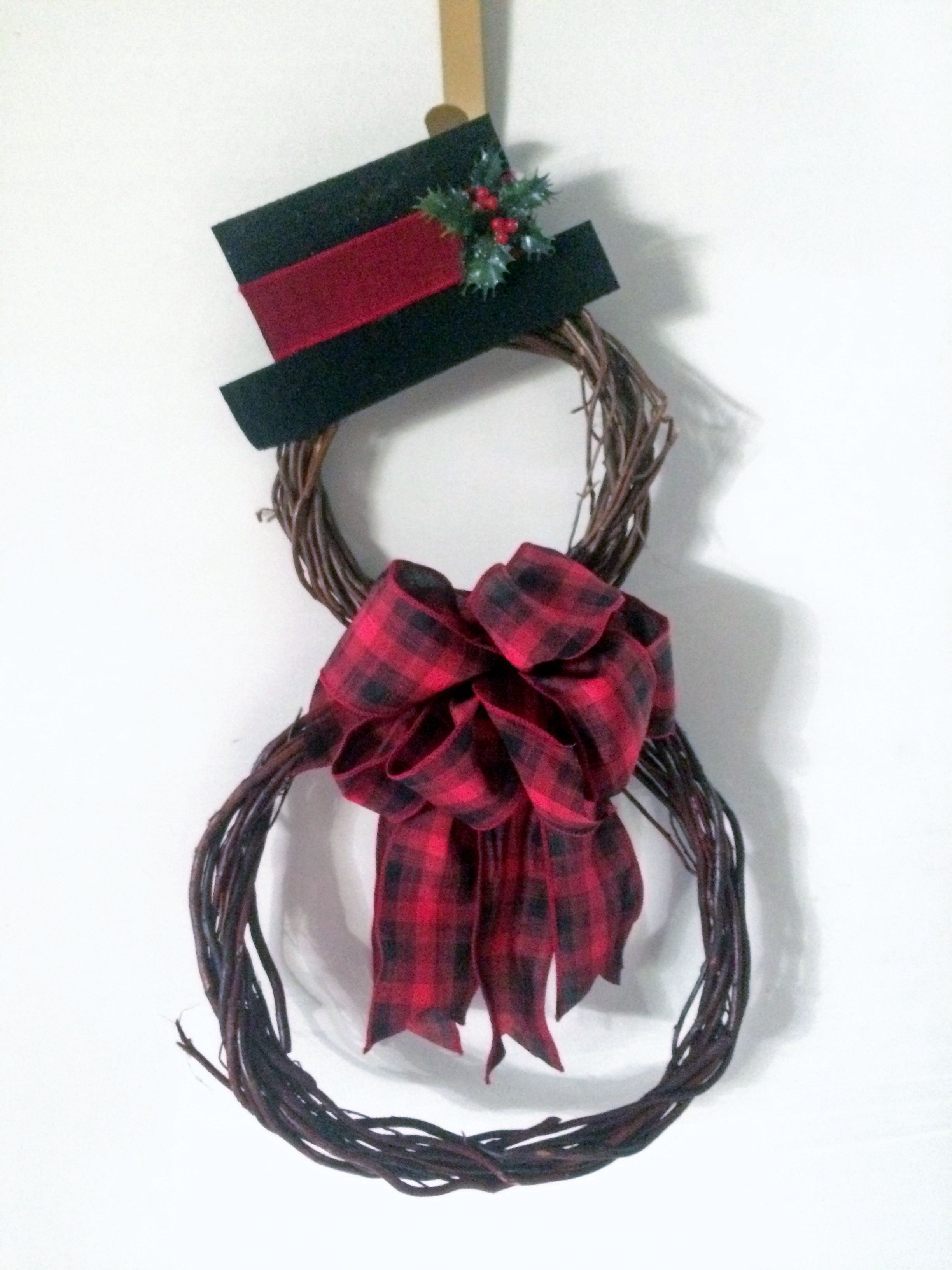 I made this with 2 grapevine wreaths from the Dollar Store