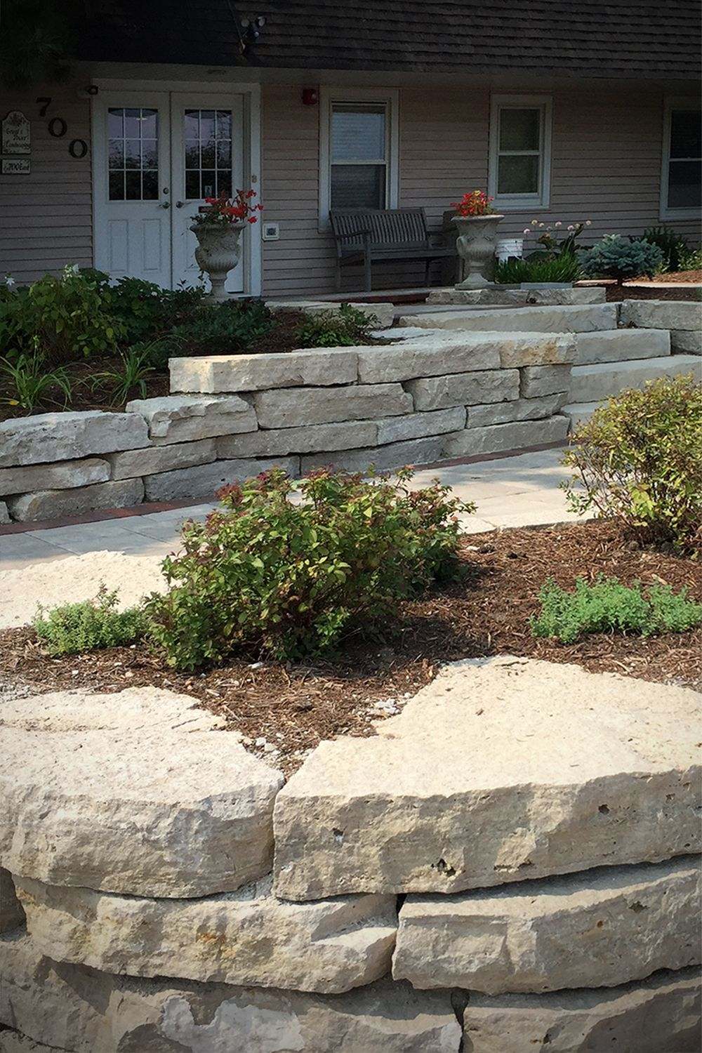 Home Landscape Retaining Wall Stone Design Fond Du Lac Outcroppings Backyard Landscaping Landscape Stone Front Yard Landscaping