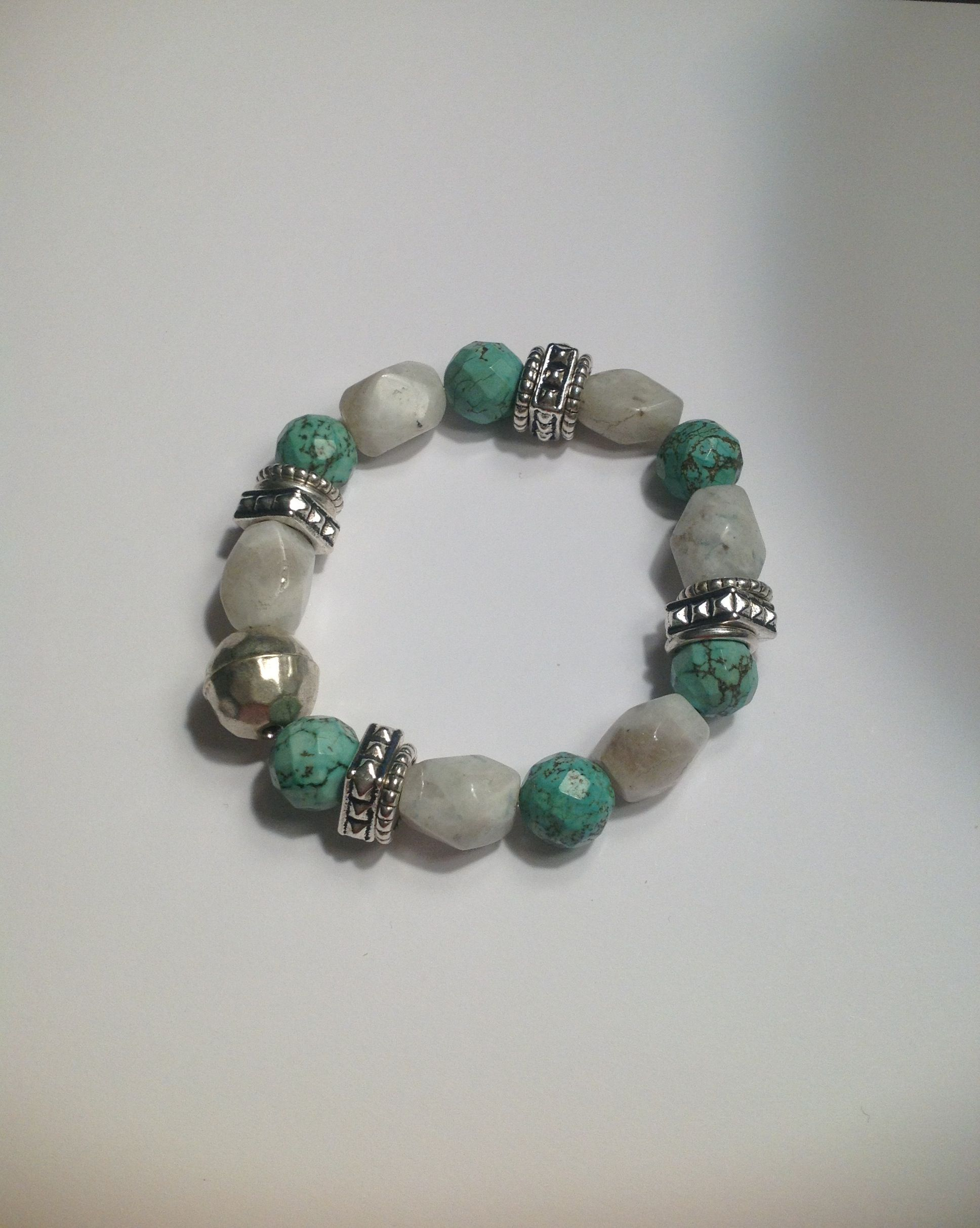 Mixture of clear white beads accented with silver toned beads and beautiful turquoise beads.  Measures approximately 7 1/4 inches