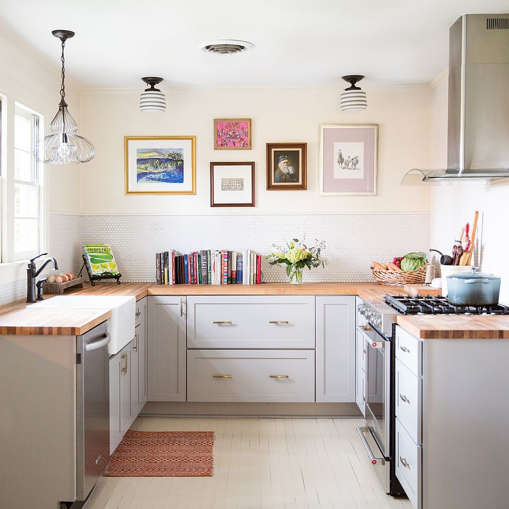 White farmhouse kitchen with wooden countertops and a