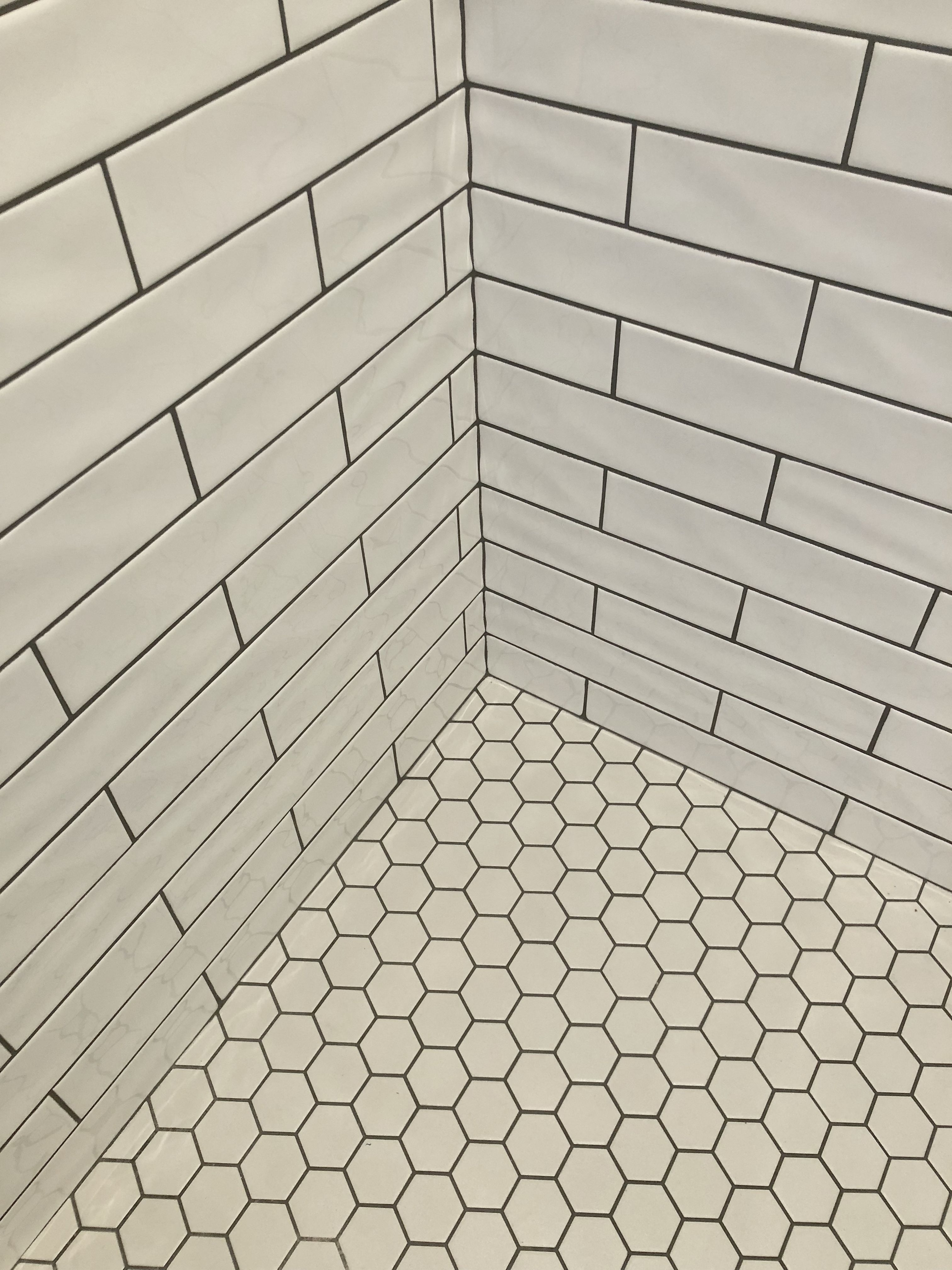 White Subway With White Hexagon Tiles For The Floor And Black Grout Love How This Look T Bathroom Tile Designs White Hexagon Tiles White Hexagon Tile Bathroom