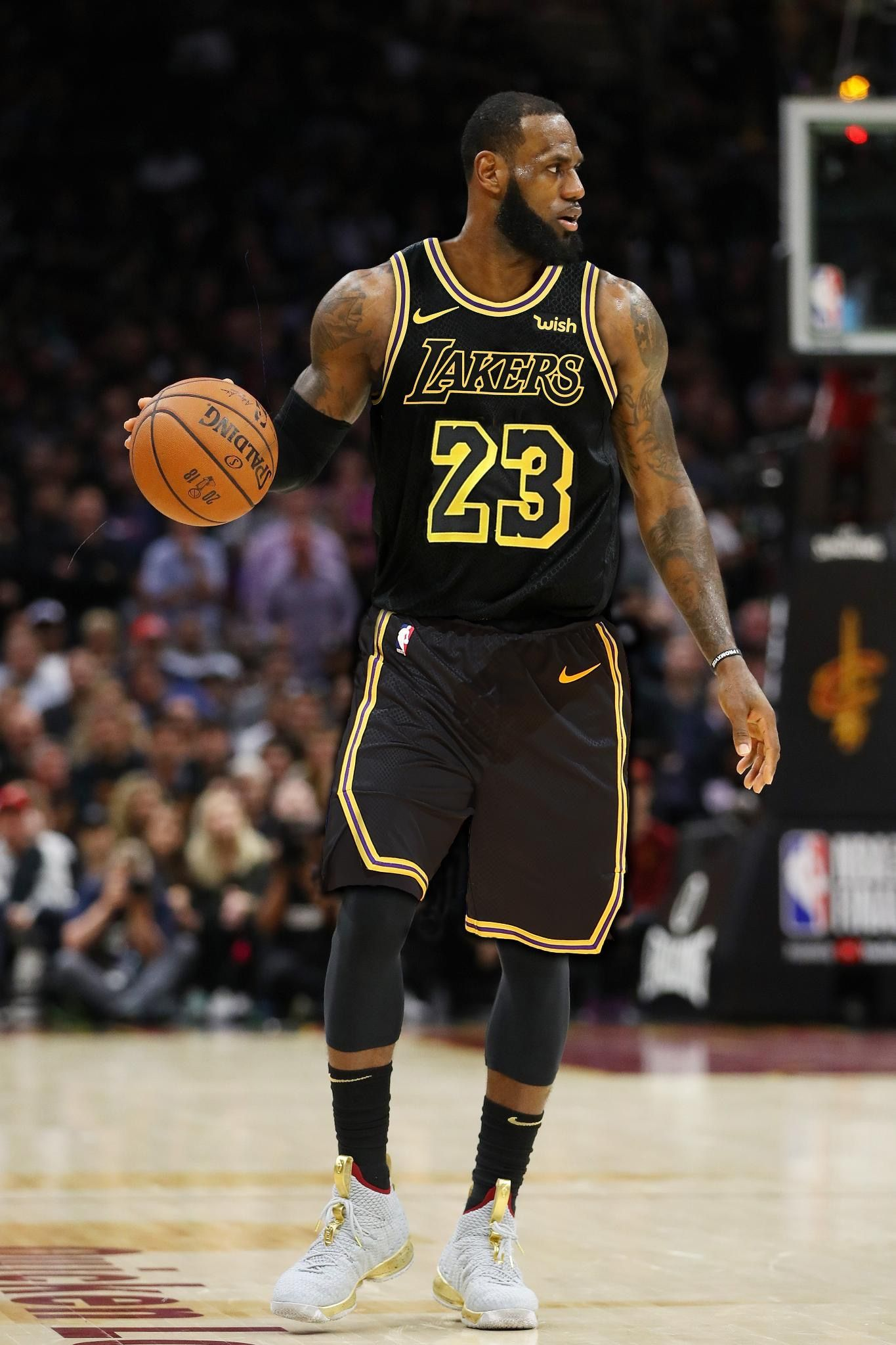 Image result for lebron james playing on black lakers jersey