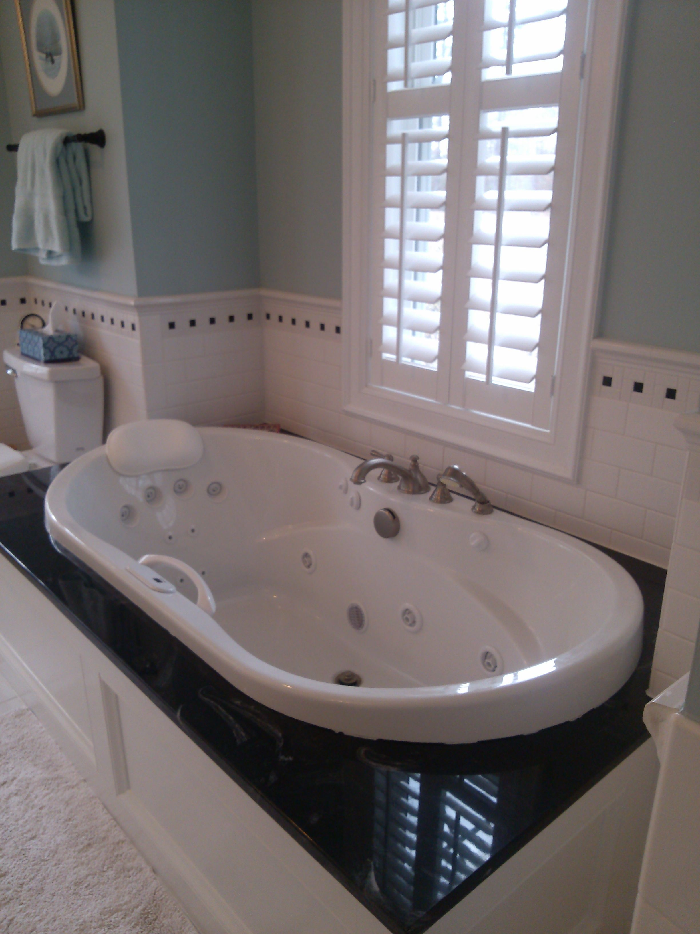 Relaxing In Luxury Black White Cultured Marble Surround Backdrops This Whirlpool Tub And Adds A Richness In Cultured Marble Whirlpool Tub Whirlpool Bathtub