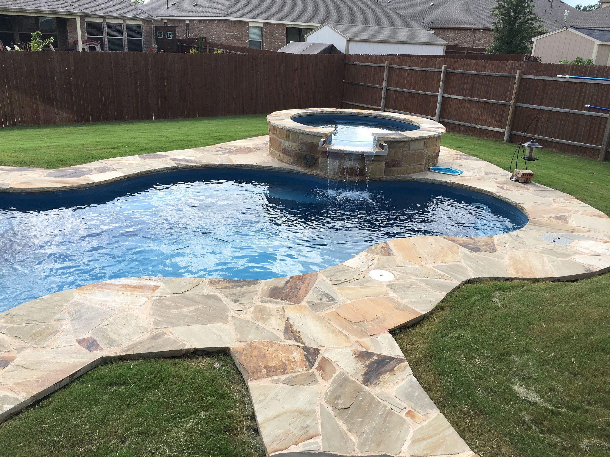 nebula and neptune spa with custom swimming pool deck stone work