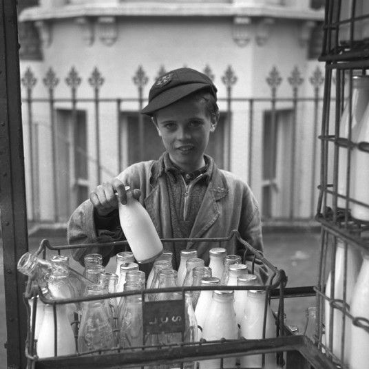 Milk delivery boy on his daily roundsin London in the 1950's