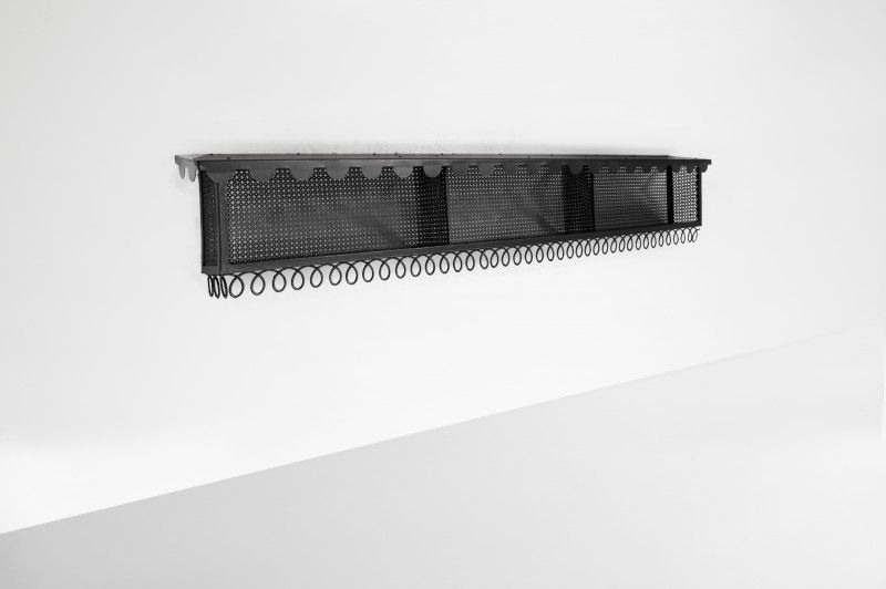 MATHIEU MATEGOT (1910-2001) Wall Mounter bookcase Manufactured by Atelier Mategot France, 1960 Lacquered and perforated metal Measurements 200 cm x 38 cm x 48h cm. 78,74 in x 15 in x 19h in. Provenance A hair salon in Paris where it was produced for.