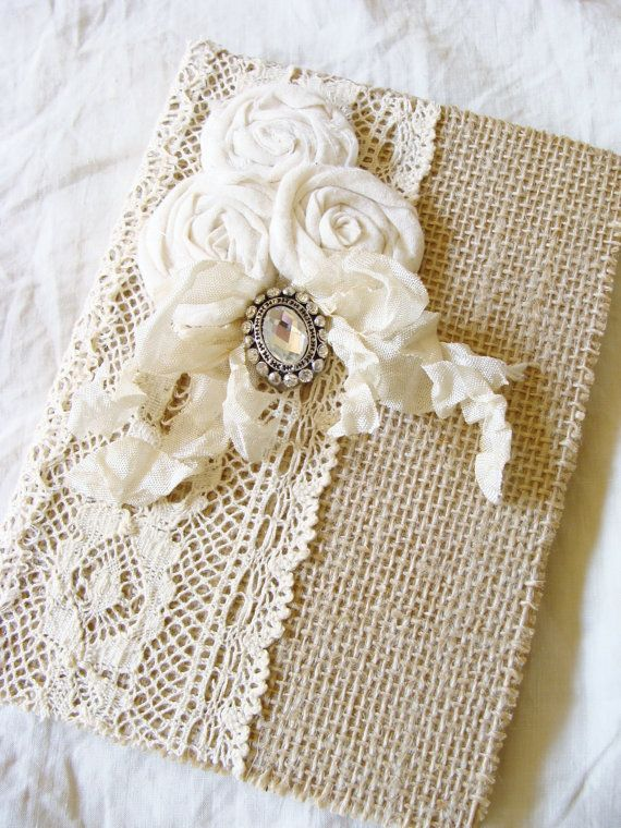 Rustic chic hardback book - covered in burlap and a variety of lace trims. Adorned with three burlap rolled roses and a vintage inspired rhinestone button over a tattered seam binding bow. The inside covers are lined with tea stained paper. Lovely gift for someone special - mother, sister, friend, use for your wedding or baby, prayer journal or gratitude journal. So many ways it can be used. This is a sturdy hardback book. Pages are lined kraft paper. 5 x 7 - 50 pages