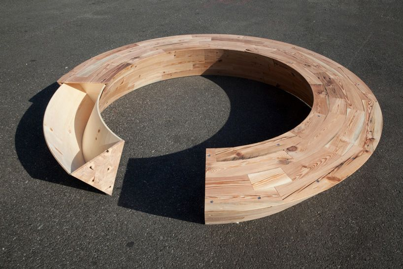 Louis Lim - Round & Round Bench at Wanted Design.  The design was presented at 12 x 12, an exhibition showing the works of twelve furniture designers using   the reclaimed lumber of twelve demolished buildings. the pieces will be auctioned off to benefit brooklyn woods, a wood shop job training   and eduction centre in NYC.