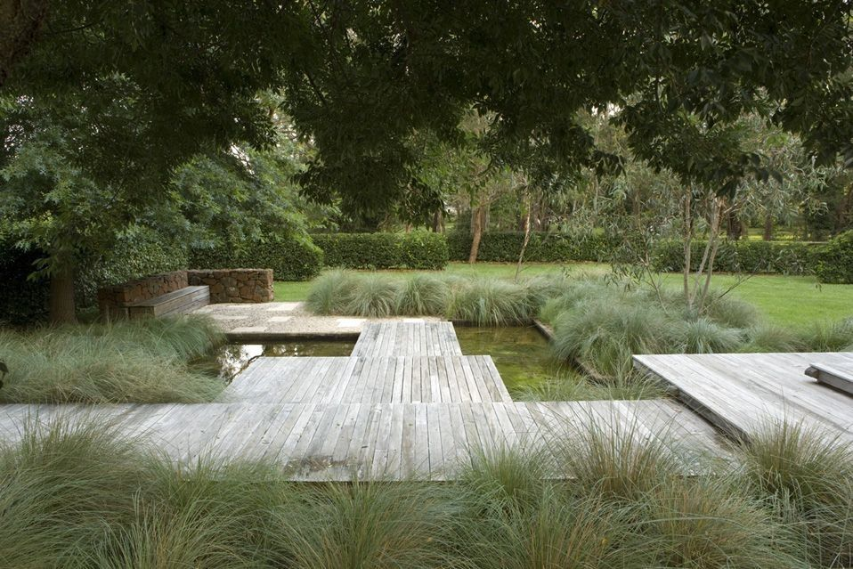 Place your fire pit in a grassy area, such as the open space toward the back of this photo.