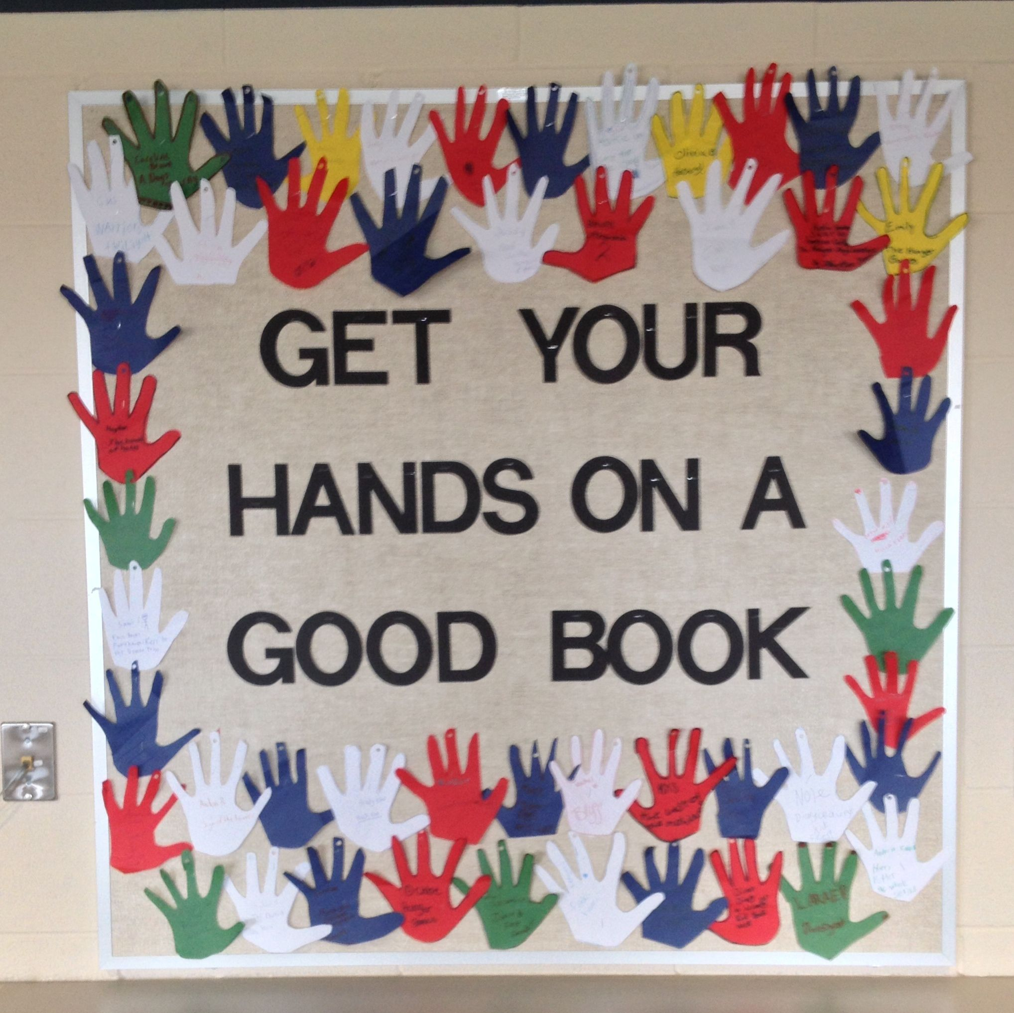 get your hands on a good book elementary school library bulletin
