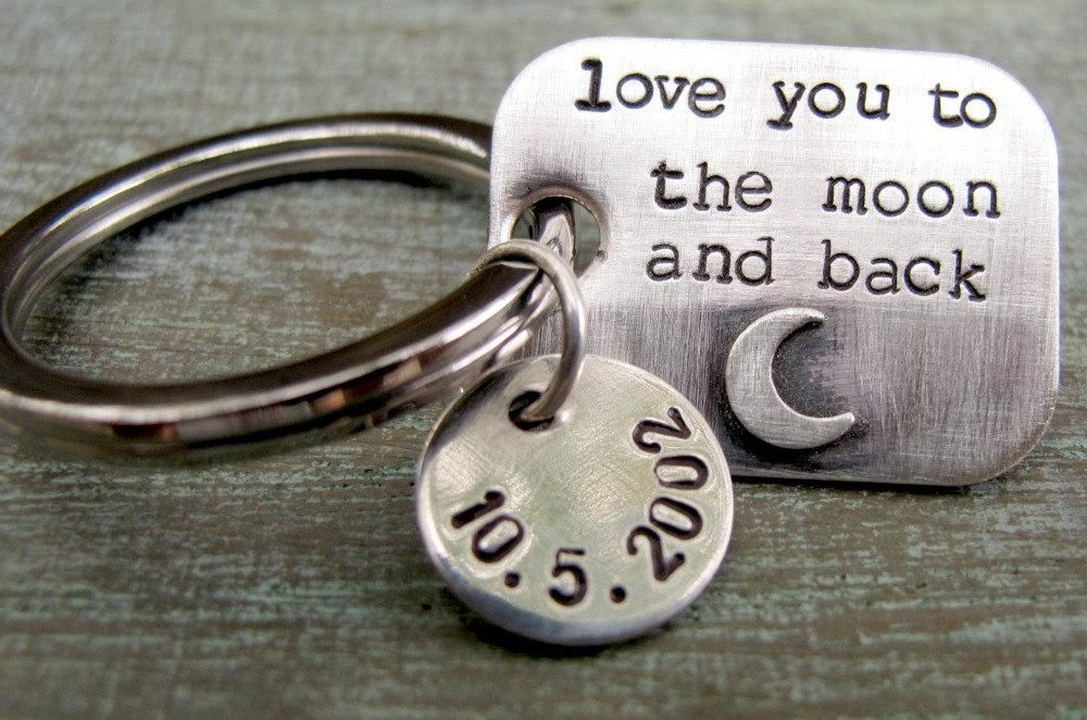 """This sterling silver rectangle shaped tag is hand stamped in my typewriter font with """"love you to the moon and back"""" with a small silver moon that I solder by hand. Includes small silver disc that can be stamped with date or a name. SIZE: Rectangle silver rectangle is attached to a stainless steel keyring and measures about 1"""" in length by 7/8"""" wide and is 20 gauge in thickness, making it a lightweight piece that is not cumbersome on the key chain. Circle measures about 1/2"""". See last photo for"""