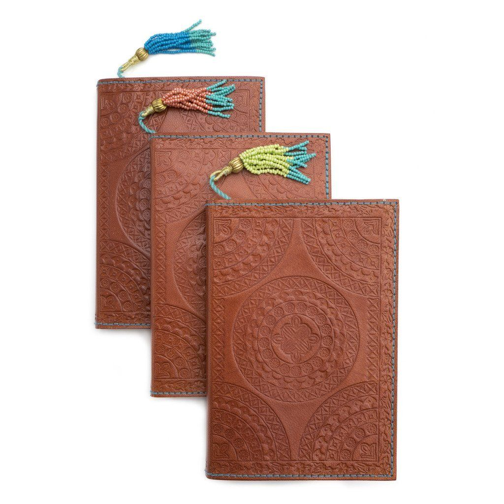 02db21cfc4135 This 4 by 6 inch 36 page tool-embossed sustainable leather journal is  stitched with thick oceanic blue cotton stitching