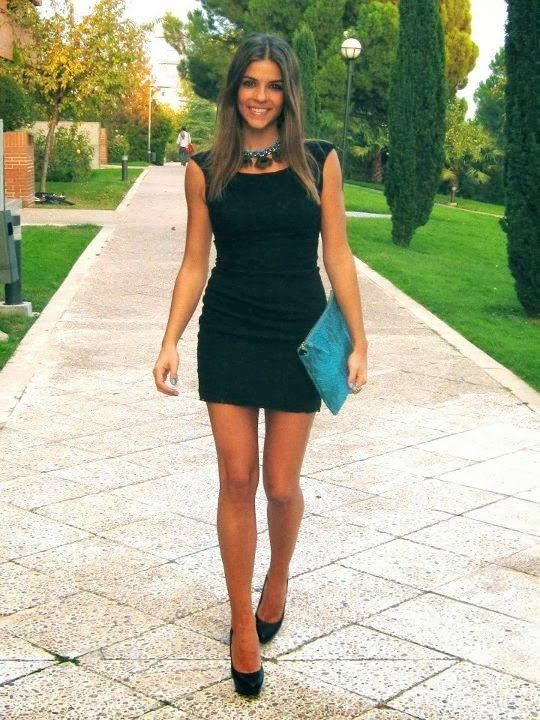 Amazing Collections, black dress and black high heels with a blue clutchs and a statement necklace..... Date night!