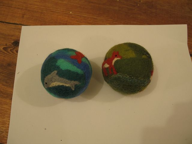 Felt balls with needle felted detail by Mereleigh, via Flickr