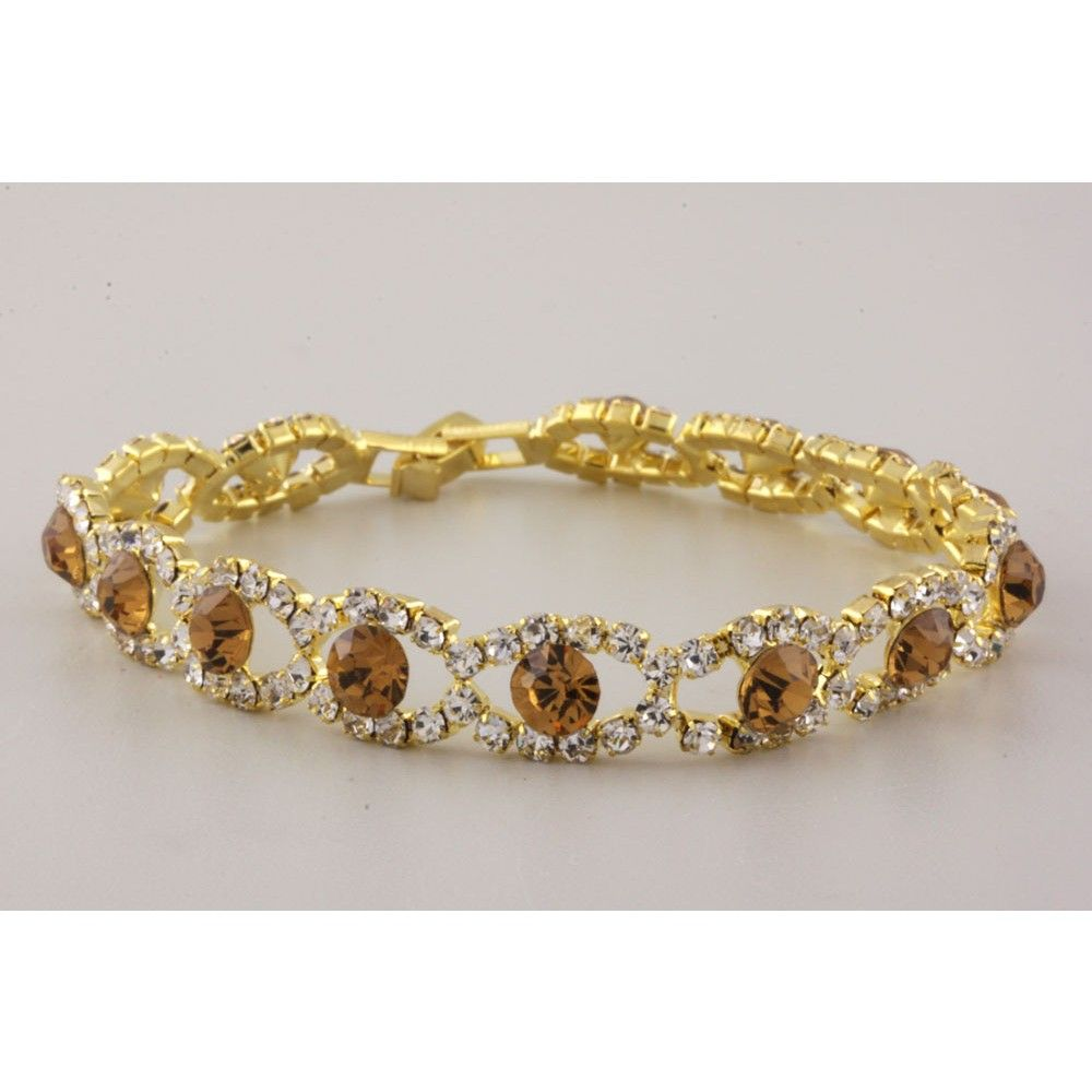 """Gold casting bracelet with clear and brown rhinestones.  Bracelet is 7"""" long and .4"""" thick.  Nickel and lead compliant."""