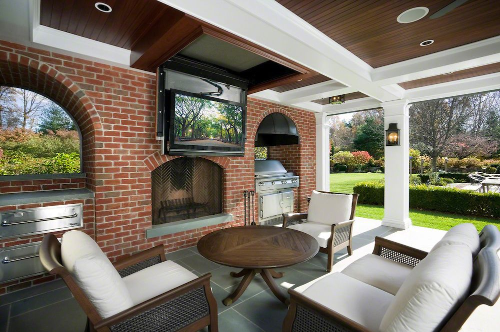 Outdoor Entertainment Area With Drop Down TV | Outdoor ... on Indoor Outdoor Entertaining Areas id=22271