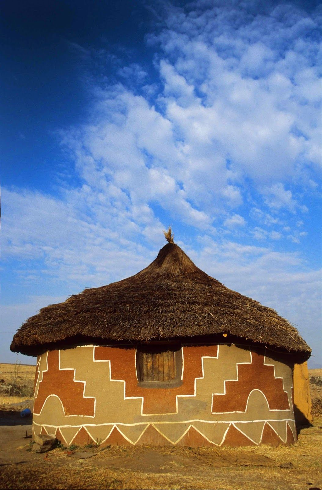 Rondavel with litema mural art of the basotho basuto or sotho ethnic group southern africa