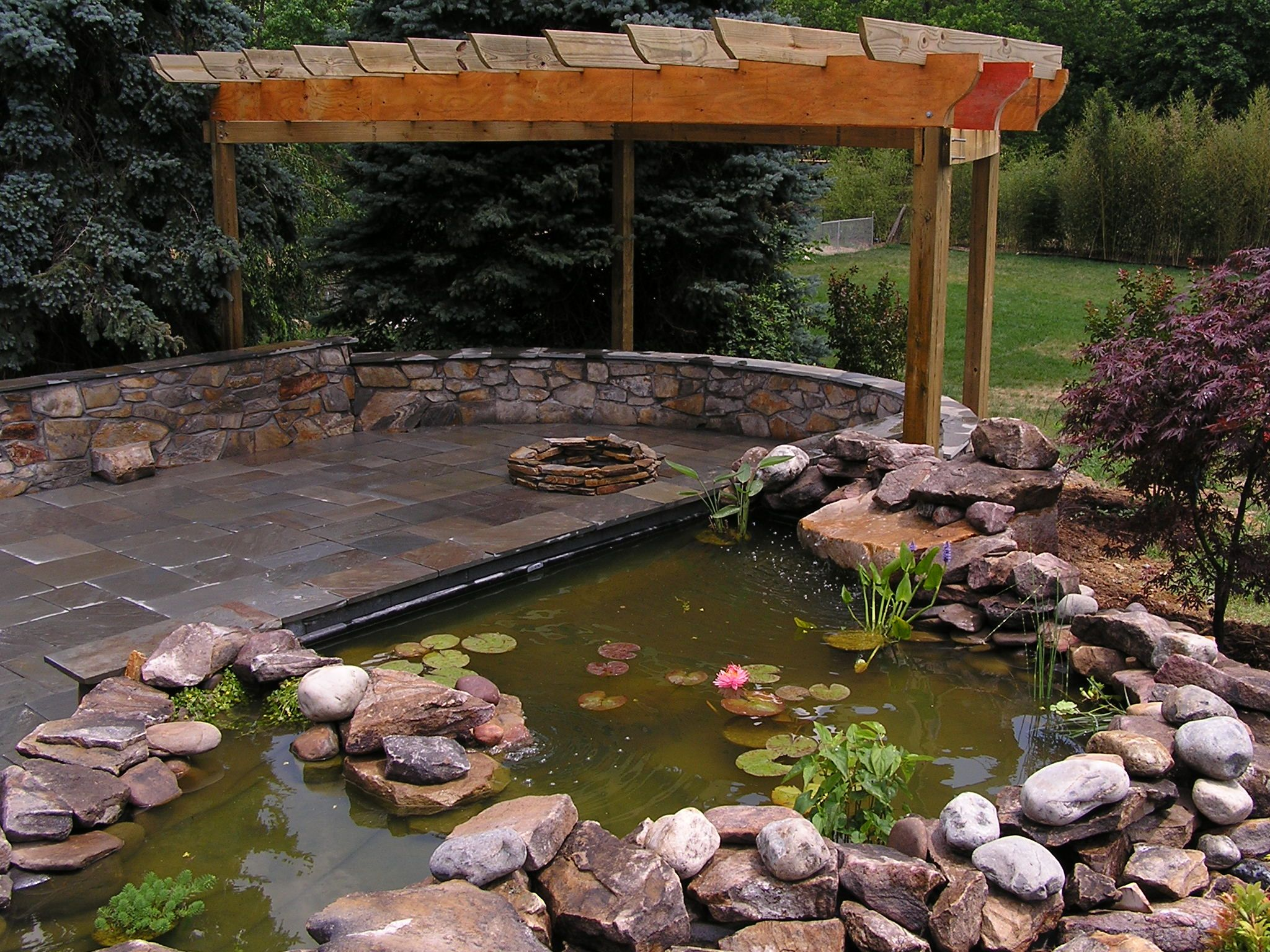 Koi pond and fire pit landscape photos pinterest for Outside pond ideas