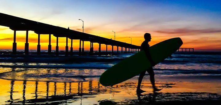 Surfer at dusk. http://ift.tt/1PwaAJe BeachCloudsGolden HourOceanOcean BeachPierSan DiegoSkySunsetSurfer
