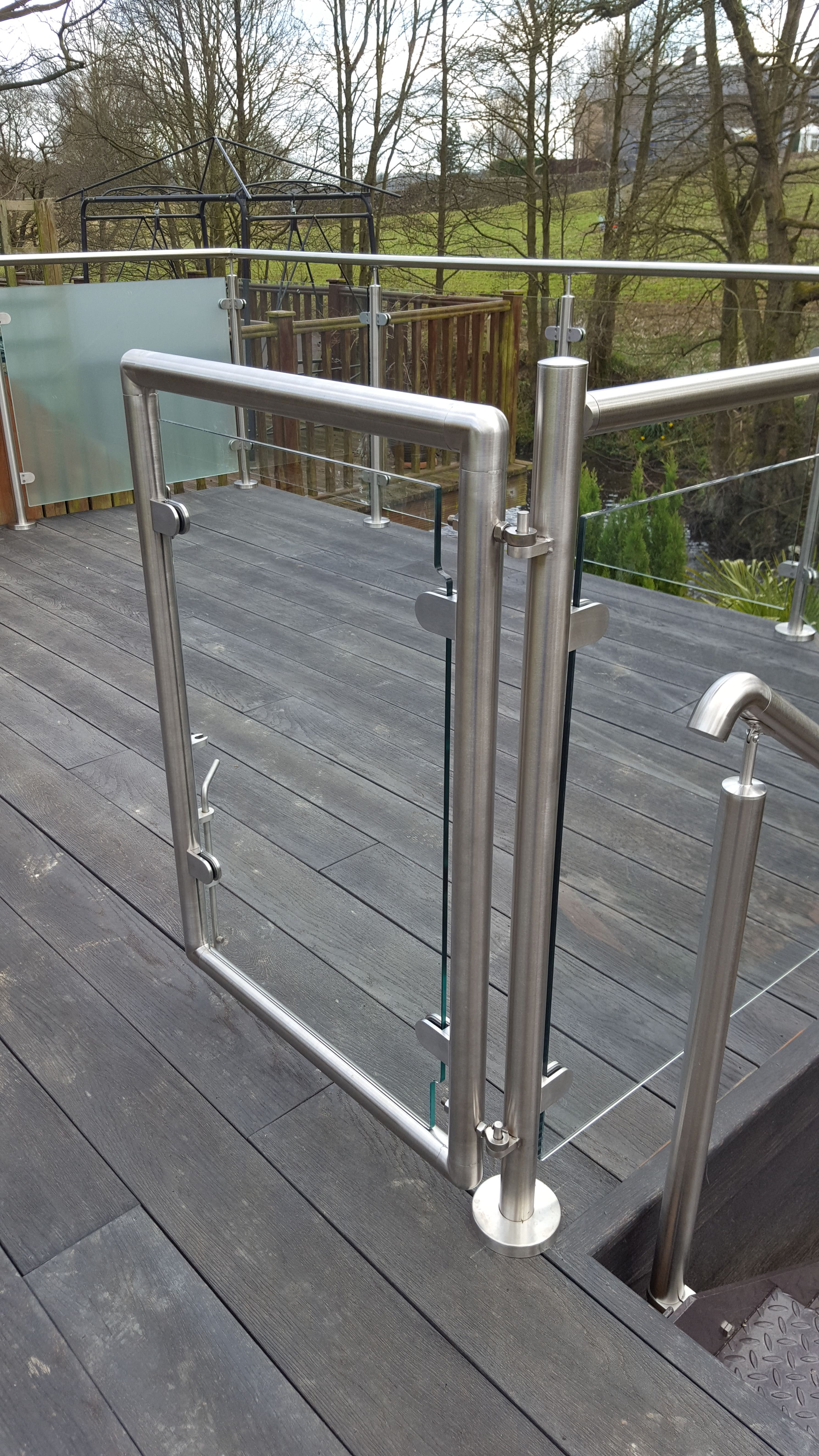 Glass balcony balustrade with gates