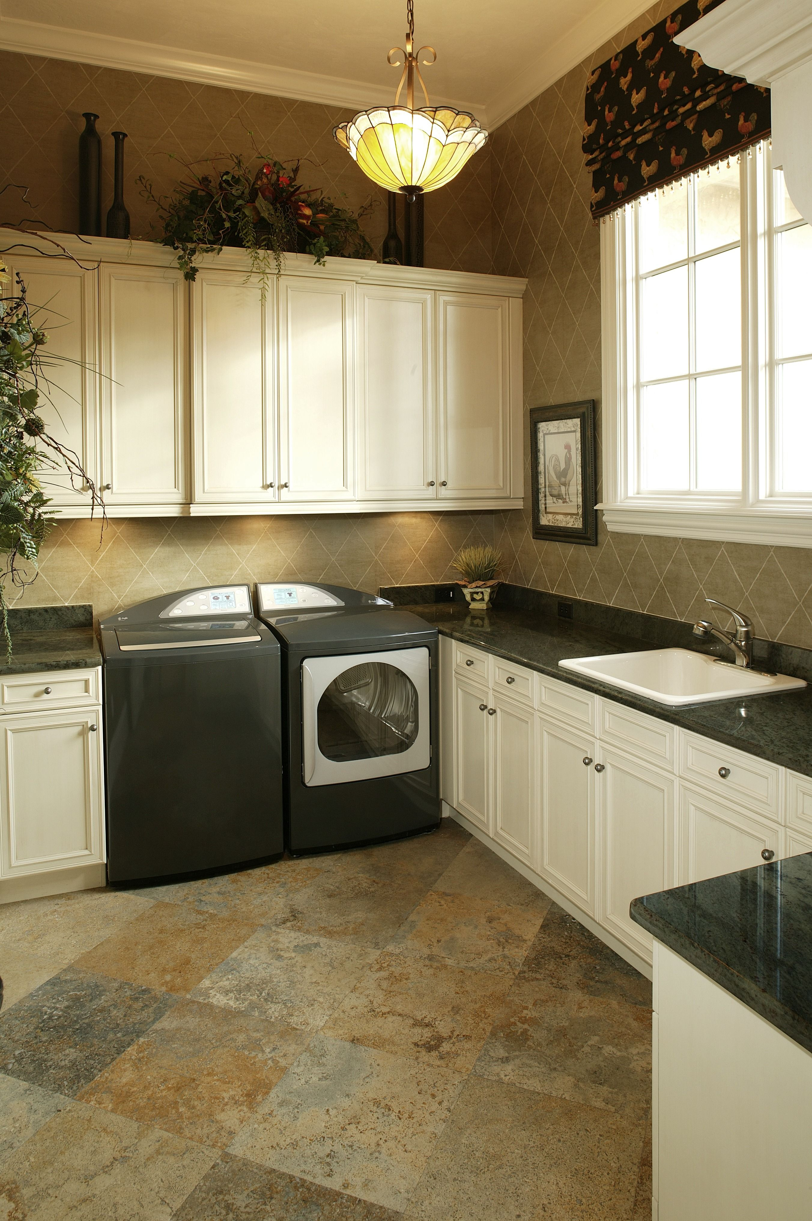 A Green Marble Countertop And Matching Appliances The Floor Is A