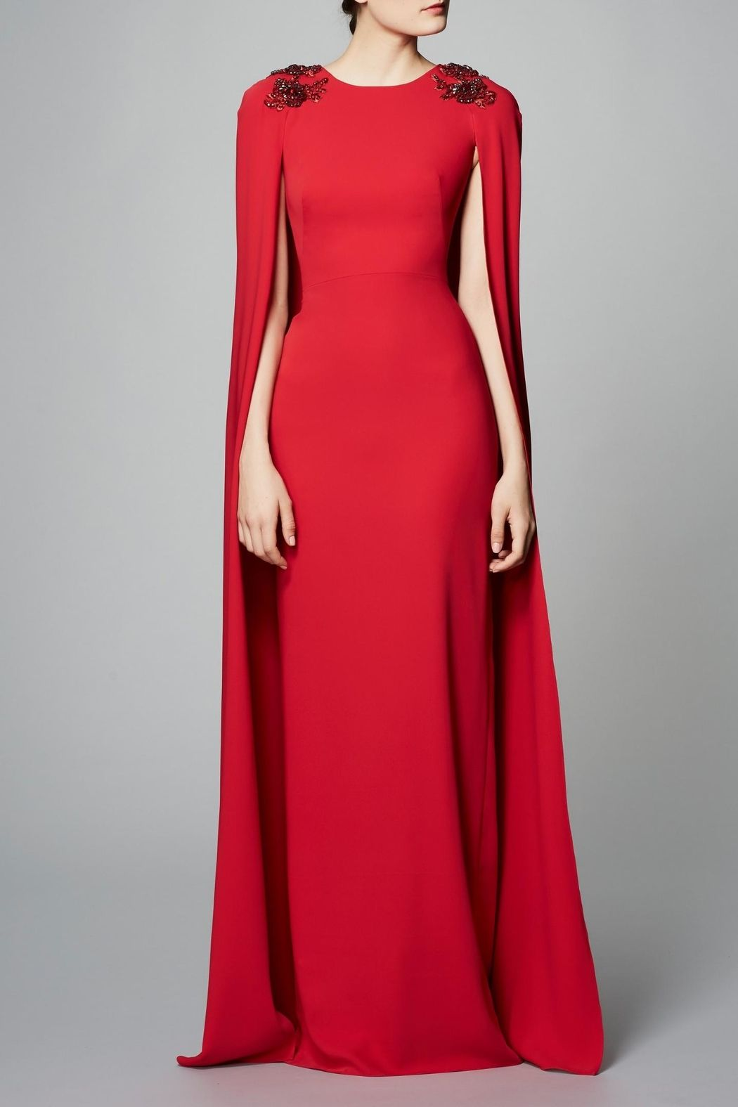 0a9e4e74f6 Stretch crepe cape gown with a jewel neckline and slim skirting. The dress  also is fitted through hip and an attached cape. Crepe Cape Gown by Notte  by ...