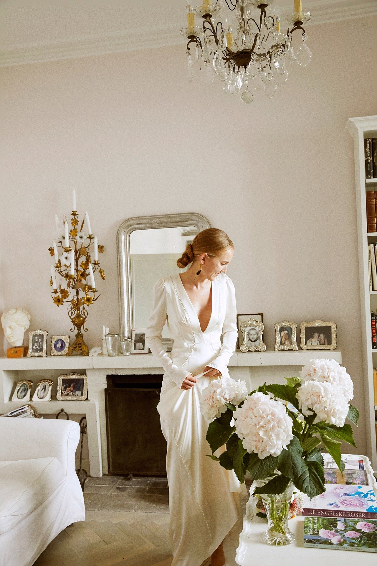 Stylist Alexandra Carl and Filmmaker Jacob John Harmer's Effortlessly Elegant Wedding in Copenhagen is part of Wedding - The bride wore a pearledged cape for her cozy yet sophisticated wedding at her childhood home