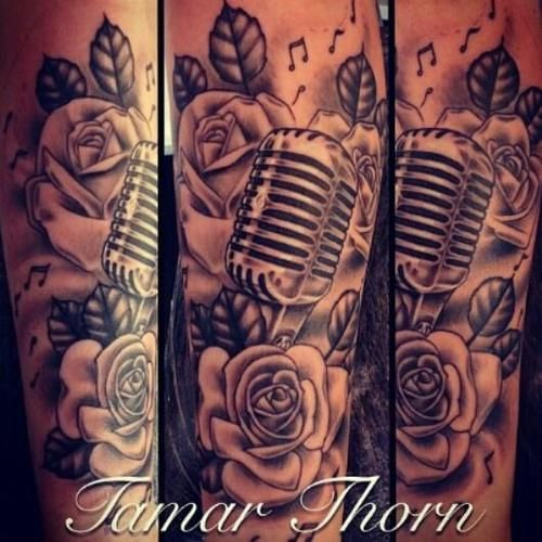 Like the microphone music notes and roses all for Rose tattoo song