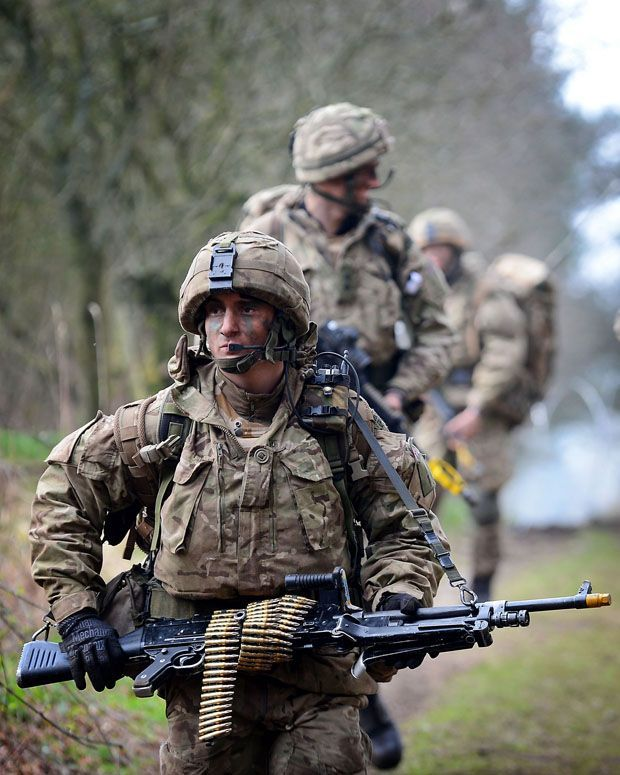 a royal marine of 40 commando leads comrades on a patrol of south