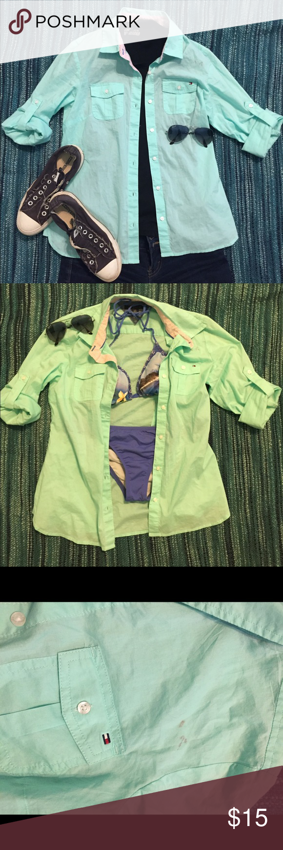 Tommy Hilfiger Button Down Shirt This is a teal/seafoam button down. It's in almost perfect condition but the two stains really put a damper on this expensive cute top. So, it's a steal in you don't mind the stains on front and back. Goes great over a bathing suit. Tommy Hilfiger Tops Button Down Shirts