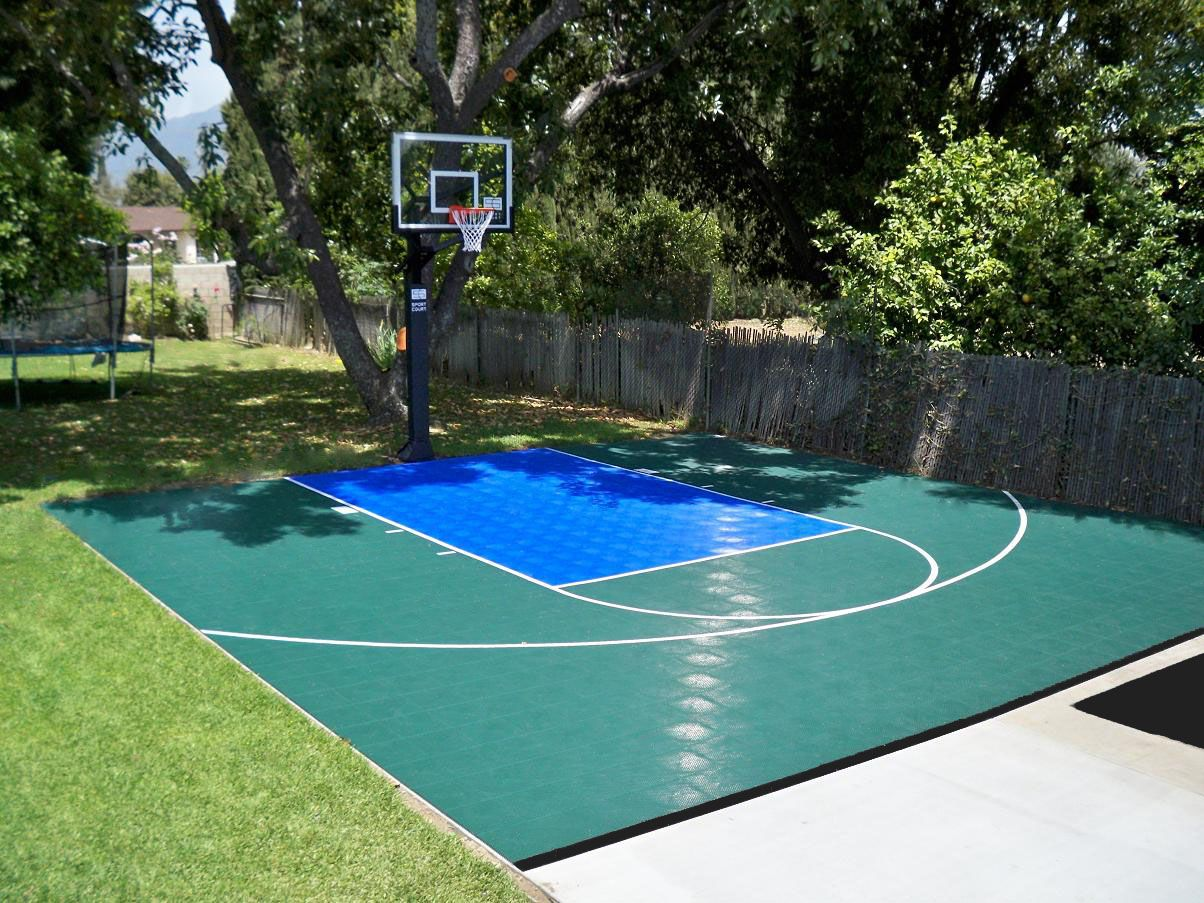 green and blue half court basketball in this backyard is perfect