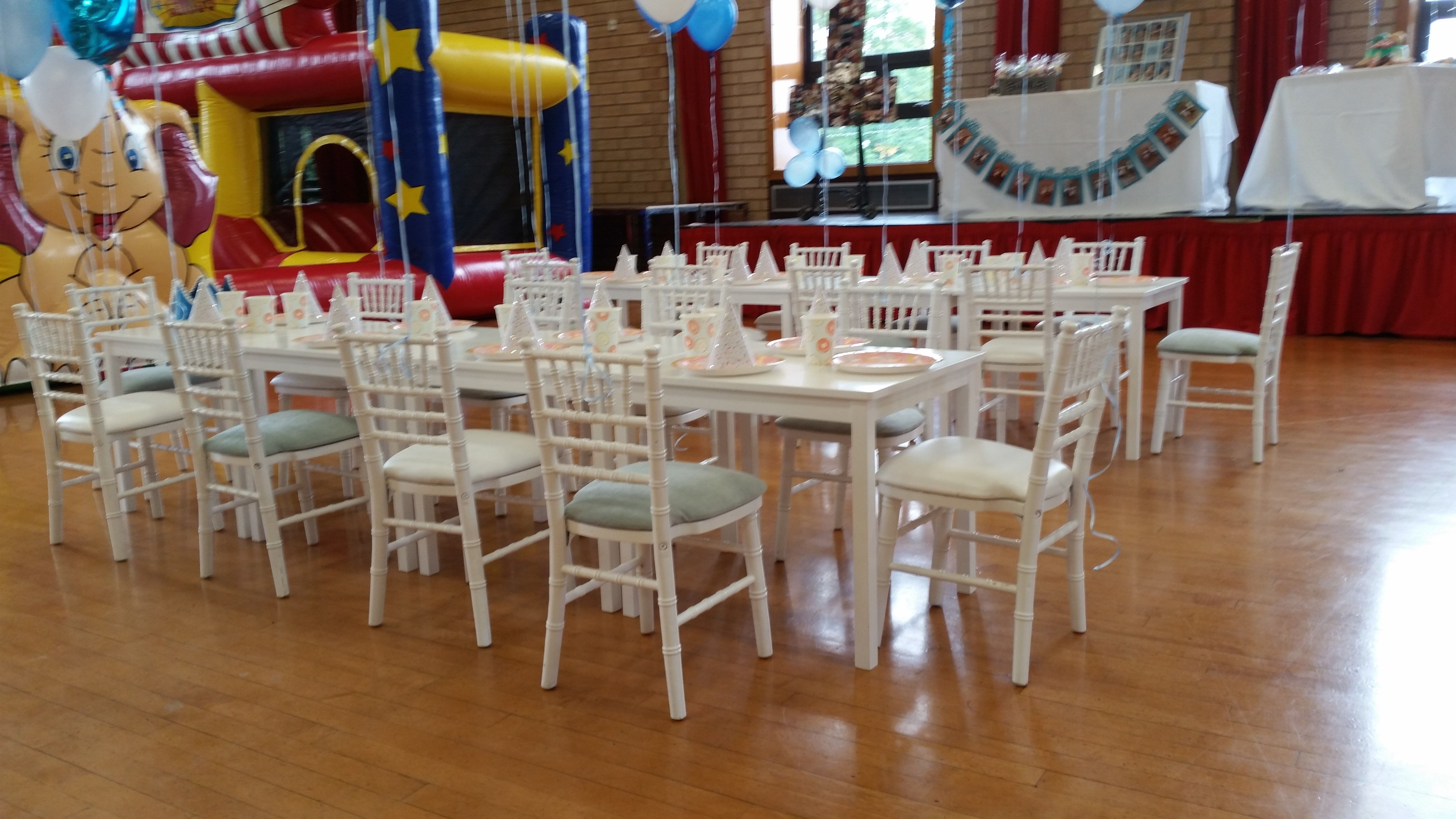 Our children's white chiavari chairs for our
