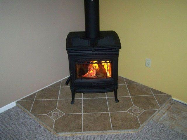 wood stove | Cast Iron wood stove on corner hearth - Wood Stove Cast Iron Wood Stove On Corner Hearth Remodel Ideas