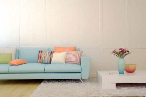 Powder Blue Sofa With Colored Cushions