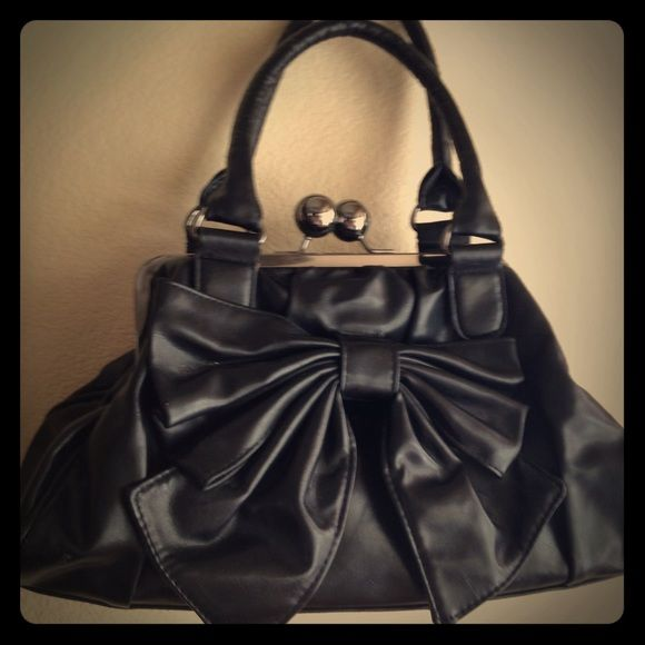 Vintage Design Black Bow Handbag Vintage retro style black handbag purse. Metal clasps. Good condition. Vintage Bags