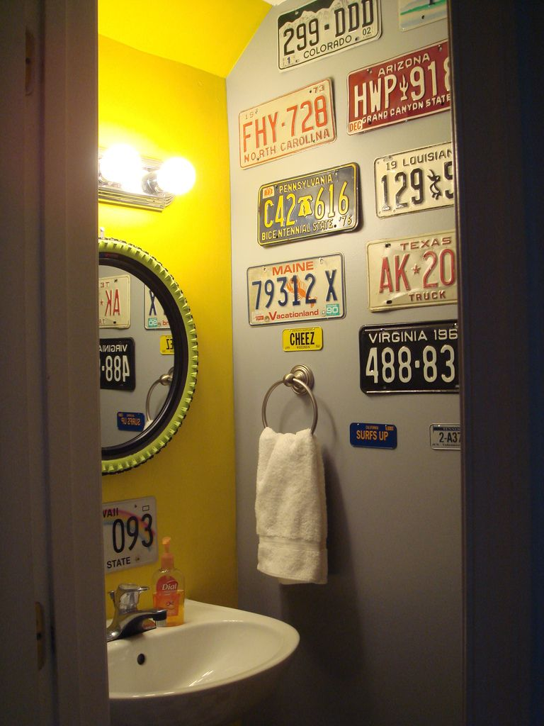 First home - Powder room, entering with view of license plate wall ...