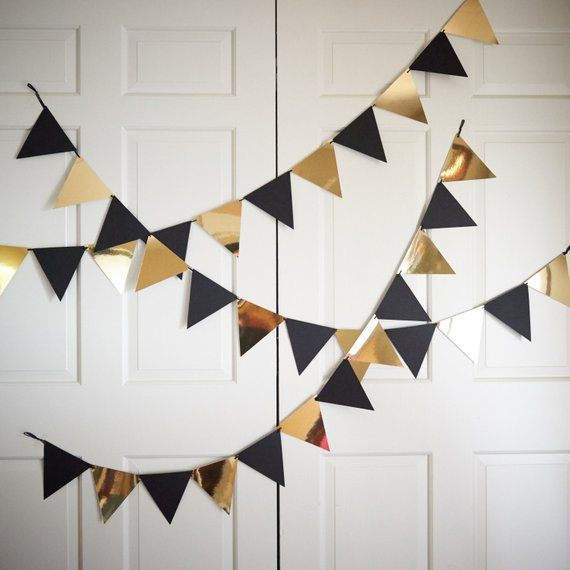 Photo of Bunting banners for black and gold party decor. Pennant banner. Photo background.