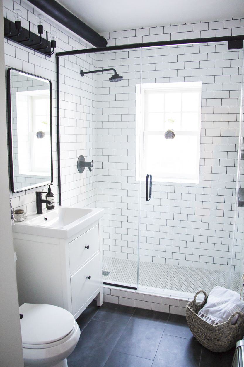 A modern meets traditional black and white bathroom for Small bathroom design black and white