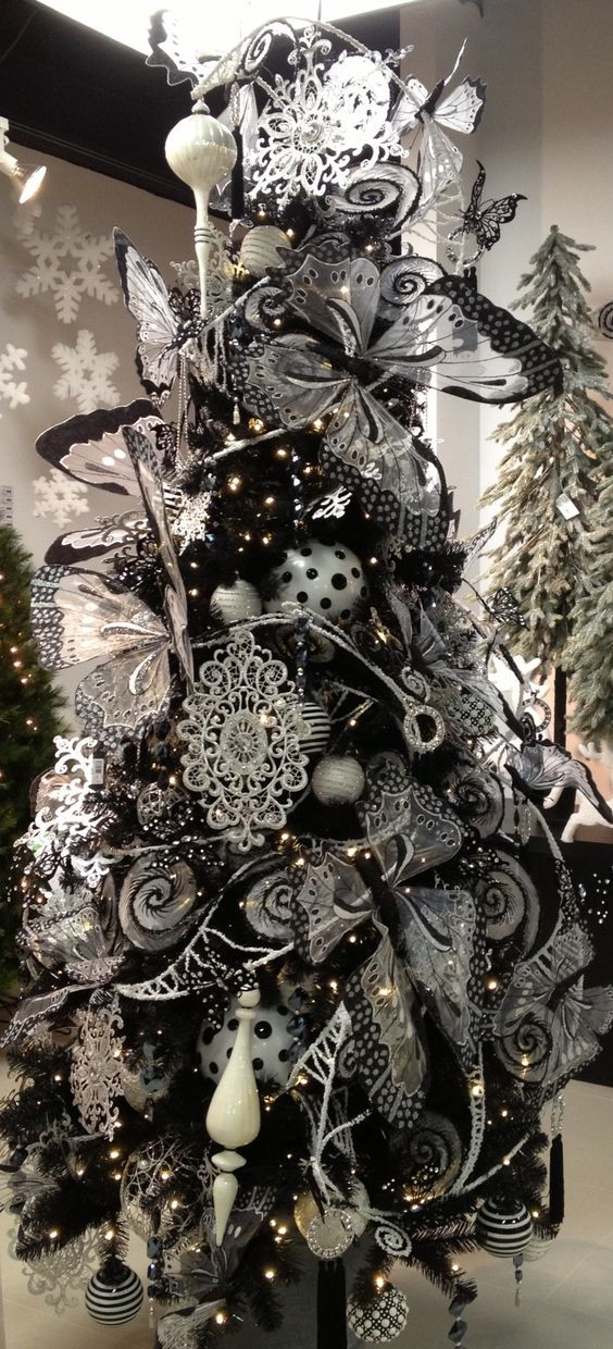 the whole tree heavily covered with romantic black and white ornaments - Black Christmas Tree Ornaments